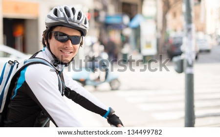 Happy Young Male Cyclist; Outdoors - stock photo