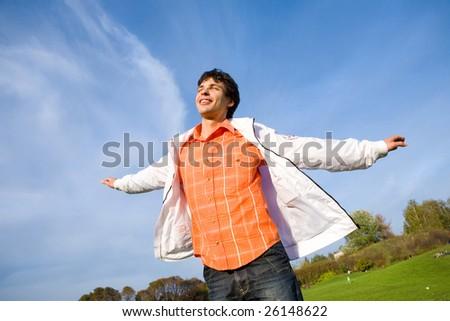 Happy young man - enjoy flies in sky - stock photo