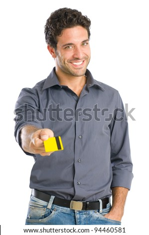 Happy young man giving credit card ready for the payment, isolated on white background - stock photo