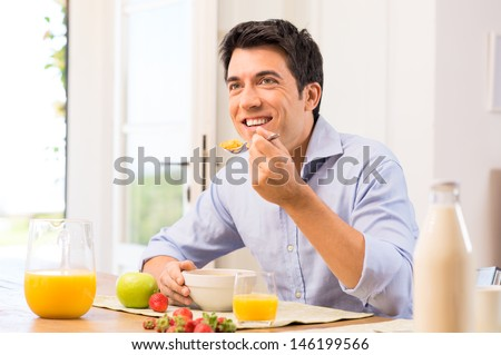 Happy Young Man Having Healthy Breakfast - stock photo
