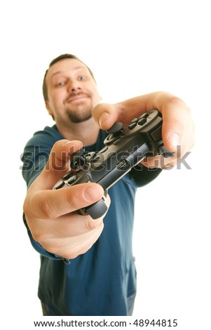 happy young man holding joystick - stock photo