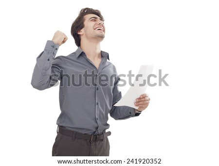 Happy young man holding the paper - stock photo