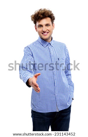 Happy young man in casual clothes standing over white background with hands on hips - stock photo