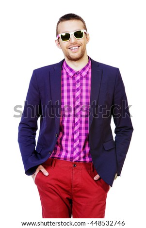 Happy young man in stylish bright clothes posing at studio. Summer fashion. - stock photo