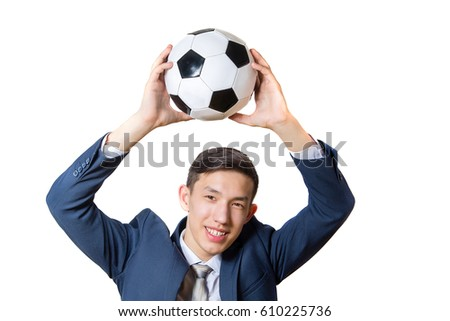happy young man in suit holding soccer ball over head isolated on white background