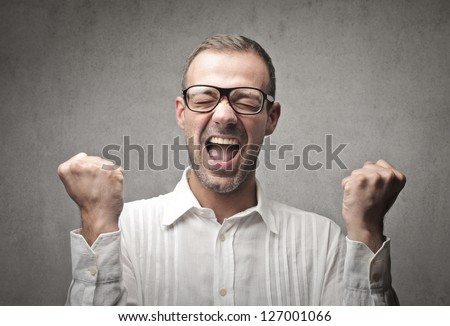 happy young man of his success - stock photo