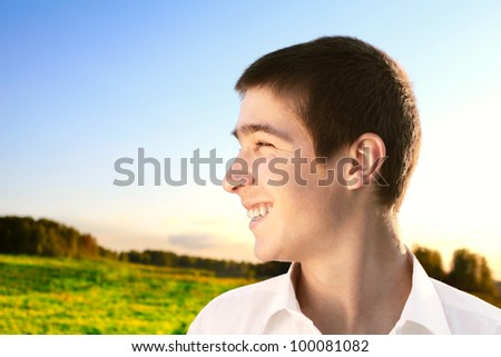 happy young man portrait in the summer field - stock photo