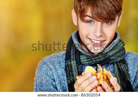 Happy young man posing outdoor. - stock photo