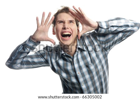happy young man shouting over white - stock photo