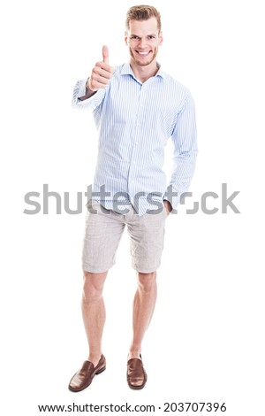 Happy young man showing thumb up - full length portrait, isolated on white background - stock photo