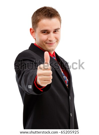 Happy young man showing thumbs up with one hand - stock photo