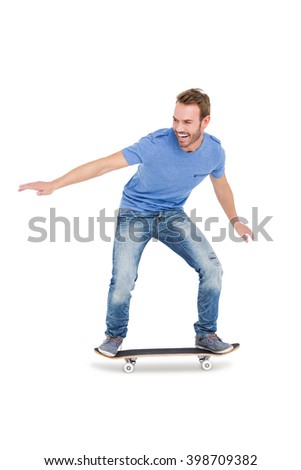 Happy young man skateboarding on white background - stock photo
