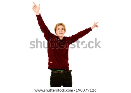Happy young man standing with his hands raised up as the winner. Isolated over white. - stock photo