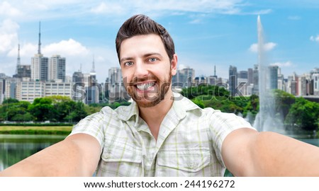 Happy young man taking a selfie photo in Sao Paulo, Brazil - stock photo