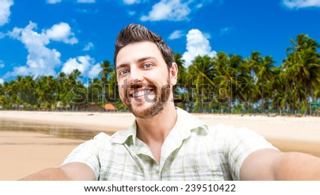 Happy young man taking a selfie photo in the Northeast of Brazil - stock photo