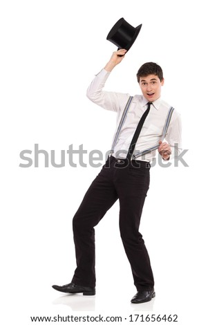 Happy young man taking hat off. Full length studio shot isolated on white. - stock photo