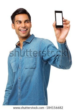 Happy young man taking self portrait photography through smart phone over white background. Vertical shot. - stock photo