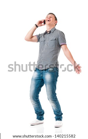 Happy young man talking on mobile, isolated on white background - stock photo