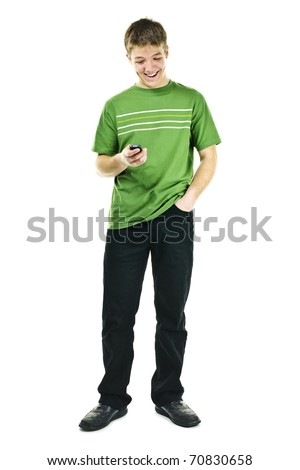 Happy young man texting on cellphone standing full body isolated on white background