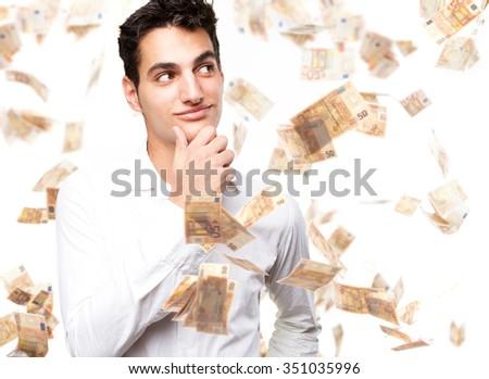 happy young man thinking - stock photo