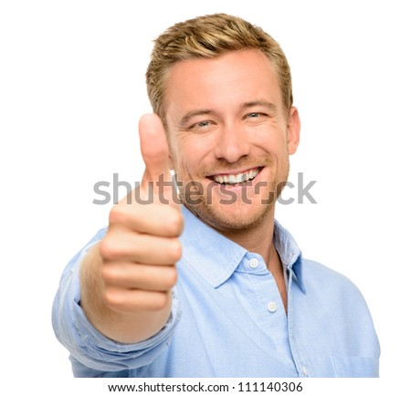 Happy young man thumbs up white background - stock photo