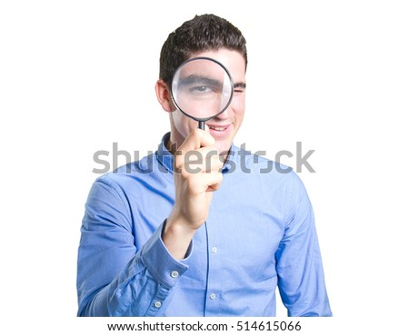 Happy young man using a magnifying glass against white background