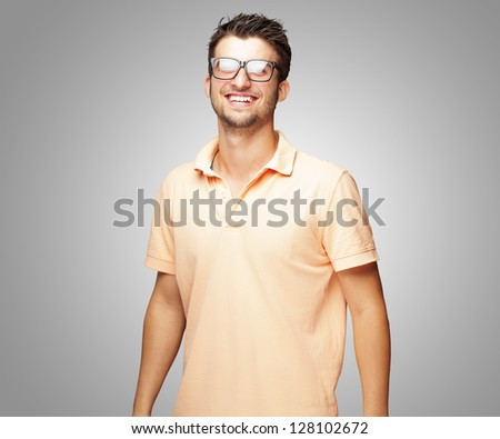 Happy Young Man Wearing Glasses On Gray Background