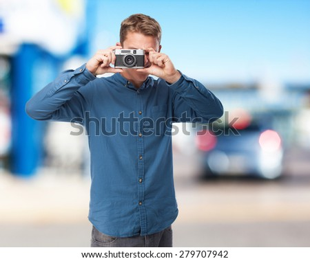 happy young-man with camera