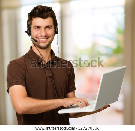 Happy Young Man With Microphone, Indoors - stock photo