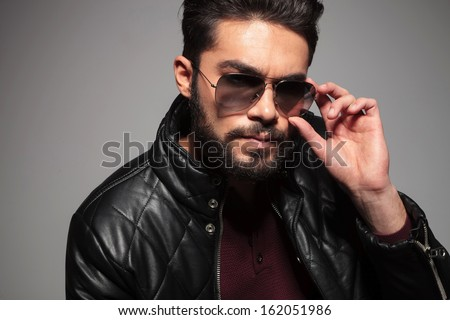 happy young man with outstretched hands looking away from the camera - stock photo