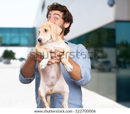 happy young man with puppy