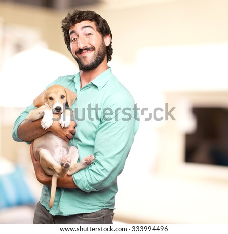 happy young man with puppy - stock photo