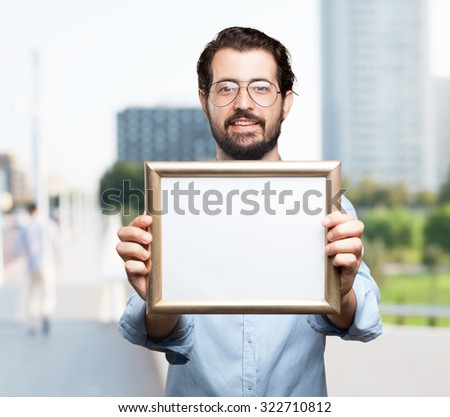 happy young man with retro frame - stock photo