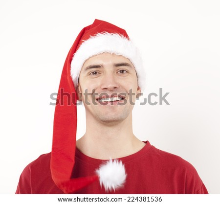 Happy Young Man With Santa Hat.