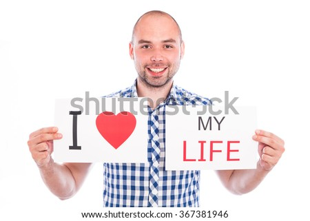 Happy young man with sign I love my - stock photo