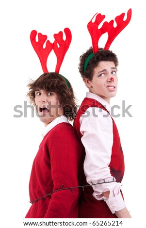 happy young men wearing reindeer horns, arrested in Christmas lights - stock photo