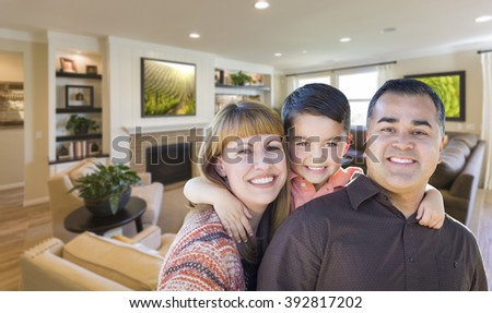 Happy Young Mixed Race Family Portrait In Living Room of Home. - stock photo