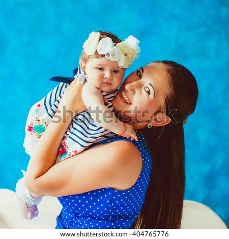 happy young mother holds her newborn baby - stock photo