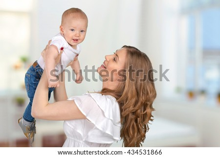 happy young mother with a child - stock photo