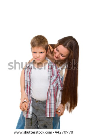 happy young mum cheers sad son - stock photo