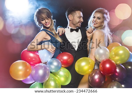 Happy young people celebrating new year's eve  - stock photo
