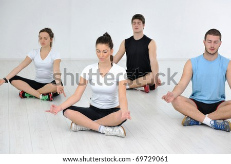 happy young people group in exercise and relax in fitness club - stock photo