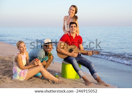 Happy Young People Having their Vacation at the Beach. Captured During Afternoon. - stock photo
