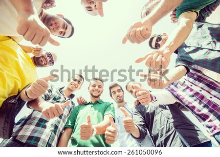 Happy young people in circle - stock photo
