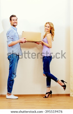 Happy young people moving to a new home. Apartment repair. Real estate, mortgage. - stock photo