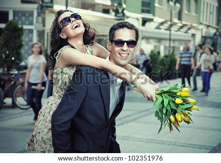 Happy young people on a city background - stock photo