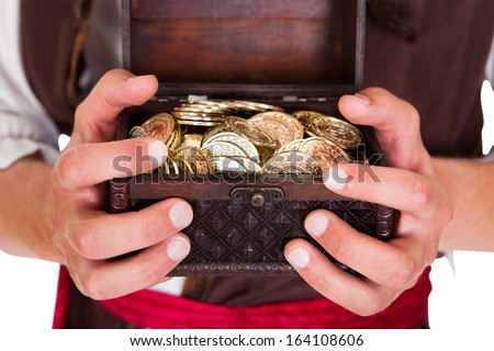 Happy Young Pirate Holding Treasure Box Over White Background - stock photo