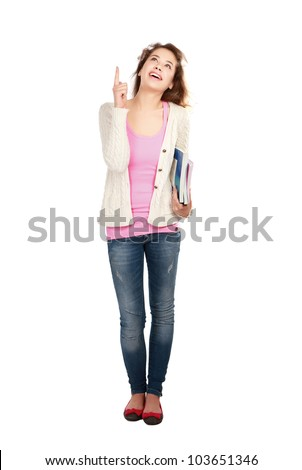 Happy young positive student pointing something interesting .Isolated on white background - stock photo