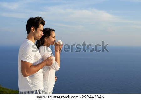 happy young romantic couple have fun relax smile at modern home outdoor terace balcony