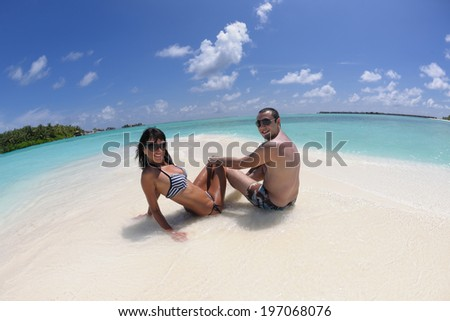 happy young romantic couple in love have fun and relaxing on beautiful beach